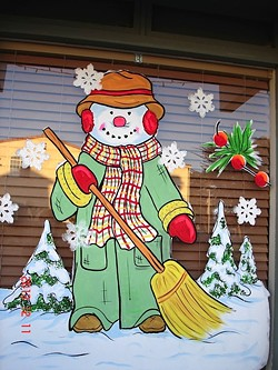 BUNDLED UP:  You can see the variety in window painting styles with Marilyn Seim's own snappily dressed snowman. - PHOTO COUIRTESY OF MARILYN SEIM