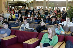 CAL POLY GETS A LESSON IN HISTORY :  A packed Cal Poly University Union inauguration viewing. - PHOTO BY STEVE E. MILLER