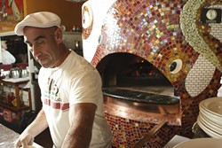 OCTOPUS MAN :  Giuseppe DiFronzo's boundless creativity extends to the new oven he designed to prepare his exquisite Italian fare. - PHOTO BY STEVE E. MILLER