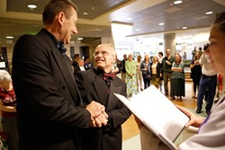 THE LOOK:  David Robinson (right) beams up at his now-spouse Gerald Lindemulder, as Rev. Helen Carroll of SLO's Unitarian Universalist Fellowship performs their wedding ceremony. - PHOTO BY STEVE E. MILLER