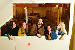 WORLD OF WINE-CRAFT :  The team of Proof Wine Collective has come together to start up the Turncoat Wine Company that's due to open in 2013 in The Creamery on Higuera in SLO. Pictured left to right are April Worley (operations), Ariel Rosso (design intern), Josh McFadden (creative director), Sarah Berger (designer), and Rachel Katra (design intern). - PHOTO BY STEVE E. MILLER