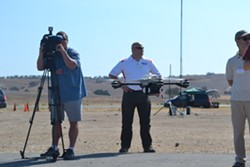 DRONE DEMO:  The InstantEye drone, manufactured by Boston-area tech company Physical Sciences Inc., hovers at Camp Roberts' McMillan airfield during a Joint Interagency Field Exploration (JIFX) event. - PHOTO BY RHYS HEYDEN