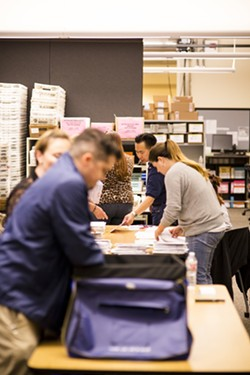 Election night in SLO County: Vote counters included Tommy Gong, candidate for SLO County Clerk-Recorder. - PHOTO BY HENRY BRUINGTON