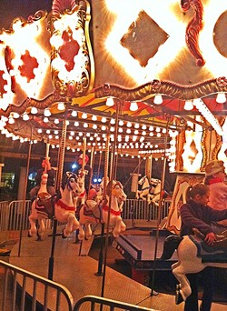 AROUND WE GO:  Like Santa's House, an old fashioned carousel is a big Christmastime tradition in the SLO Mission Plaza. - FILE PHOTO BY GLEN STARKEY