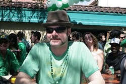FIXTURE :  Chad Holcomb, a McCarthy's regular, weathers the crowd of amateurs on St. Paddy's Day. - PHOTOS BY GLEN STARKEY