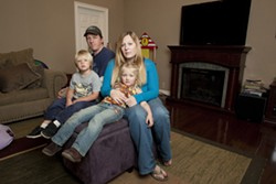 GETTING BY :  Molly O'Leary and Ryan Risley are getting by now, but they don't know how they'll afford to stay at home with their kids if a $250-per-month sewer bill forces them both to work full time. - PHOTO BY STEVE E. MILLER