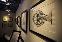 SOMETHING FISHY:  Joseph Kalionzes taught himself printmaking techniques, and his works are pulled from hand-carved linoleum and wood blocks. - PHOTO BY KAORI FUNAHASHI
