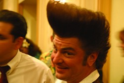 HOW HIGH CAN YOU GO? :  People go all out on their hair, like this guy's pompadour!