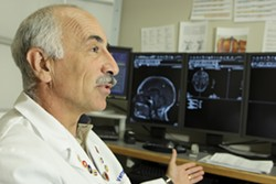 TRICKSTERS :  Dr. Fred Vernacchia's administrative costs are rising, but insurance companies are tricky in how they reimburse doctors. - PHOTO BY STEVE E. MILLER