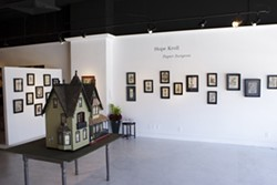 PAPER SURGEON :  One of the most intricate pieces in Hope Kroll's exhibit at Vale Fine Art (pictured) is a fully furnished dollhouse that took the artist 10 years to complete.
