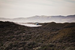 GRASS FIGHT:  A helicopter recently circled above the Guadalupe-Nipomo National Wildlife Refuge, spraying an herbicide being tested to manage veldt grass, an invasive species that threatens to adversely impact the dune scrub habitat. - PHOTO BY KAORI FUNAHASHI