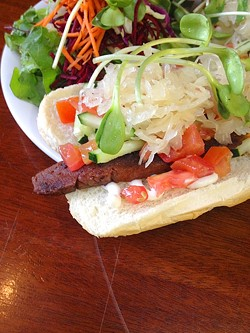 THE SMILING DOG:  Bliss Café in downtown SLO offers up vegan hot dogs that feel decadent, but actually rack up good karma points instead. - PHOTO BY HAYLEY THOMAS