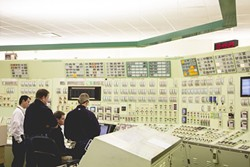 UNDER CONTROL:  At the heart of Diablo Canyon sits its control center, where technicians monitor identical sets of instrumentation for each of the plant's two reactors. - PHOTO BY HENRY BRUINGTON