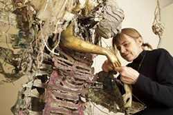 """FINAL TOUCHES :  Pictured is Higby hard at work before the opening of her exhibit """"Noh Works."""" Her sculptural costumes, made of wood, silk, gold leaf, ceramic, lacquer, fabric, and paper, can take years to complete. - PHOTOS BY STEVE E. MILLER"""