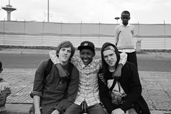 """REBELS FOR A CAUSE:  Cambrian local Sean Stromsoe (left) founded Ethiopia Skate with Abeneezer """"A.B."""" Temesgen (center) to build a skate park in Addis Ababa, Ethiopia. - PHOTO BY JOEY MALONEY"""