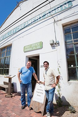 DAIRY LIFE:  Third-generation dairy farmer and Harmony Valley Creamery owner Alan Vander Horst (left) aims to restore and refresh Harmony's historic creamery building with a restaurant serving up Swiss-Italian grub and a creamery shop featuring fresh cheese curds, milk, butter, semi-soft cheeses, and ice cream. Project manager Tom Halen (right) provides the hospitality know-how. - PHOTO BY KAORI FUNAHASHI