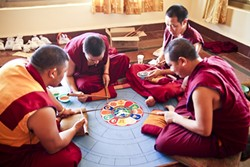 """MIND PALACE:  The sand mandala typically takes several days to create. The mandala is described as the """"imaginary palace of the Buddha,"""" and is visualized during meditation. Upon its completion, the sand mandala is ceremonially destroyed, symbolizing the impermanence of all that exists. - PHOTO COURTESY OF ANET CARLIN"""