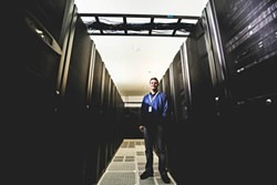 SERVER FARMER:  Tim Williams, founder and CEO of Digital West, a San Luis Obispo-based data storage and web hosting company, has pioneered efforts to improve telecom infrastructure—and incorporate more fiber-optics—in SLO County. - PHOTO BY HENRY BRUINGTON