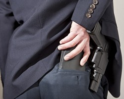 OUT OF SIGHT, ON THE MIND :  More San Luis Obispo County residents have applied for concealed weapons permits in the last two years than in the previous two. - PHOTO ILLUSTRATION BY STEVE E. MILLER