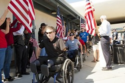 WELCOME! :  Wounded American and British war veterans arrived Sept. 25 at the SLO Regional Airport for Operation Surf, a rehabilitative surfing program. - PHOTOS BY STEVE E. MILLER