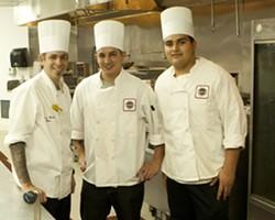 CHEFS O'PLENTY :  Chefs Andrew Kossuth, Jimmy Ramirez, and Efren Alvarez work in a huge kitchen behind the fresh food cabinet.