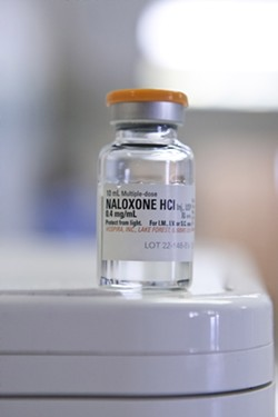 REVIVER:  Naloxone—commonly known as Narcan—is administered to victims of heroin overdose to counteract the drug's effect on the brain. The patient will come to within seconds, said one emergency technician. - PHOTO BY STEVE E. MILLER