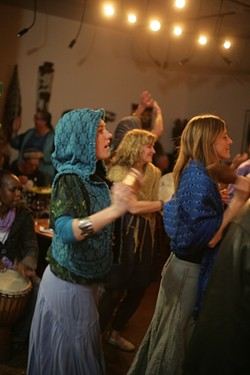 BLISS OUT!:  The energy in the room is palpable as attendees dance for rain. - PHOTO BY GLEN STARKEY