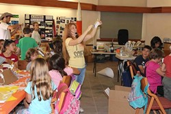 PUTTING THE FUN IN FUNDAMENTALS:  In addition to her online science business, Aurora Lipper holds yearly science camps designed to show kids how awesome science is. These camps include activities like building flying contraptions, liquid nitrogen experiments, and laser light shows using optical tables that the students built. - PHOTO COURTESY OF AURORA LIPPER