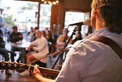 INTIMACY:  A small but appreciative crowd eats up Mulgrew's every word and note during a recent Bang the Drum Brewery performance. - PHOTO BY GLEN STARKEY
