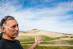 ENOUGH IS ENOUGH :  Gianni Manucci, owner of Wild Coyote Estate Winery and Bed and Breakfast, is upset about a project on the property next door that includes new winery facilities and events. - PHOTO BY KAORI FUNAHASHI