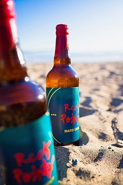 APPLE OF YOUR MOUTH:  Made in Cayucos by local boys, it made perfect sense that these frosty bottles of Reef Points Kid Neptune hard cider would be enjoyed at the inspiration's source. - PHOTO BY KAORI FUNAHASHI