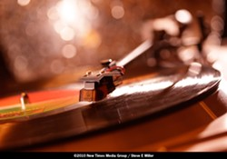 """CURVACEOUS :  Records are the appetizer, main course and dessert at """"Vinyl in the Woods."""" - PHOTO BY STEVE E. MILLER"""