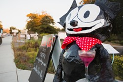 FELIX FELICIS:  Felix the Cat, created by Deborah Scarborough, Charlotte Goforth, and Beezie Moore greets guests of the Black Cat Bistro with a message of 'Save Water, Drink Wine.' - PHOTO BY KAORI FUNAHASHI