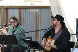 """SUPERSTARS IN OUR MIDST :  Emmy-winning composer and multi-instrumentalist Danny Pelfrey (left) and Steve Miller Band member Kenny Lee Lewis do justice to Van Morrison's """"Moondance"""" at a Hospice fundraiser at Sustenance. - PHOTO BY GLEN STARKEY"""
