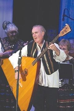 HE'S EITHER REAL SMALL OR THAT'S A BIG GUITAR :  Take a sonic trip to Russian on April 4 when the Red Barn Community Music Series presents Big Rock Balalaikas in St. Benedict's Church. - PHOTO COURTESY OF BIG ROCK BALALAIKAS