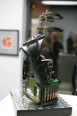 """MY FAVORITES! :  While the show is chock full of awesome art, my favorite piece was Larry Le Brane's """"Combat Stilettos,"""" constructed completely by hand of fused glass, switchblade knives, ammo, hardware, found objects, and """"G.I. Jane compacts."""" - PHOTOS BY GLEN STARKEY"""