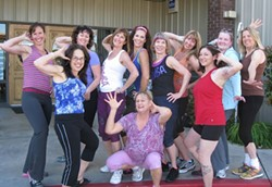 MOVERS AND SHAKERS UNFORTUNATELY, :  Sue Scheel explained, the group's only male participant was on vacation when this picture was taken at Champions Health Club in Atascadero. Malinda, the Zumba instructor, is in the middle (long brown hair and pink headband). Sue is next to her in the black Zumba top. - PHOTO COURTESY OF SUE SCHEEL