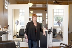 HIGH LIGHTS:  Marcia Beck stands by styling stations. - PHOTO BY STEVE E. MILLER