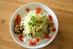 LO AND BEHOLD:  The popular Lo Fu is named after KunFusion chef and owner Lori Nunes, who crafted the tasty, health-conscious mix of hearty tempeh, - yellow onion, aromatic spices, crisp broccoli slaw, guacamole hummus, and juicy diced cherry tomatoes. - PHOTO BY TOM FALCONER