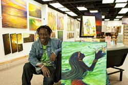DANCING WITH COLOR :  Abbey Onikoyi recently moved his art space, Spirits of Africa Gallery, to the more visible 672 Higuera St. in downtown San Luis Obispo. Born and raised in Nigeria, Onikoyi has called the Central Coast home since 2002. - PHOTO BY STEVE E. MILLER