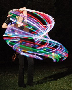 RAINBOW ROAD:  Laurie Hobbs, one of the founders of Fluid Luminescence, teaches hoop-dancing workshops. - PHOTO BY STEVE E. MILLER