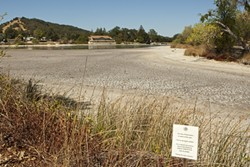 LAKE WOEBEGONE:  Atascadero Lake, a popular destination for tourists and locals alike in wetter times, has been a stinky, expensive headache for the city during this dry, hot summer. - PHOTO BY STEVE E. MILLER
