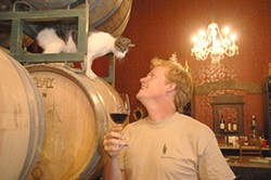 VINTNER DAN STARK AND WINERY CAT: - PHOTO COURTESY OF THE INDEPENDENT MAGAZINE