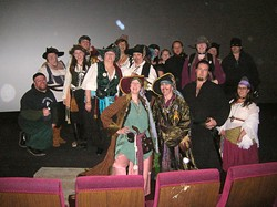 MOTLEY CREW:  About two dozen pirates and assorted pirate-friendly locals volunteered to pull off the fundraiser for Enhancement, Inc. - PHOTO BY RYAN MILLER