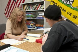 TEA PARTY TEACHER :  High School teacher Lora Dixon believes in accountability but is frustrated with the test driven, standardized instructional methods recently imposed on the Paso Robles Unified School District. Also pictured is student Hazen Knowles. - PHOTO BY STEVE E. MILLER