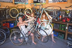 READY TO RIDE:  Some of the designers from the SLO Bike Coalition's fashion show model their pieces with their wheeled inspirations. - PHOTO COURTESY OF SLO BIKE COALITION