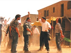 SNAP-OFF:  Jews and Palestinians engage in an expertly choreographed snapping fight in Ari Sandel's satirical short 'West Bank Story.' - PHOTO COURTESY OF WEST BANK STORY