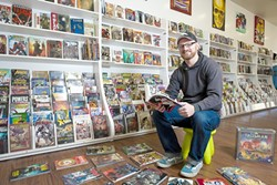 THE DOCTOR IS IN :  Reid Cain is convinced that he can convert non-comic book fans through his new shop in downtown SLO. - PHOTO BY STEVE E. MILLER
