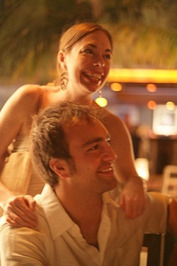 LOVE GLOW :  Rubey and Gabe share a laugh with friends at their rehearsal dinner in Playa del Carmen, Mexico. - PHOTO BY GLEN STARKEY