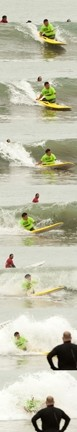 CHARGING! :  Triple amputee and British veteran Martin Pollock drops into a wave at Cayucos pier. - PHOTOS BY STEVE E. MILLER